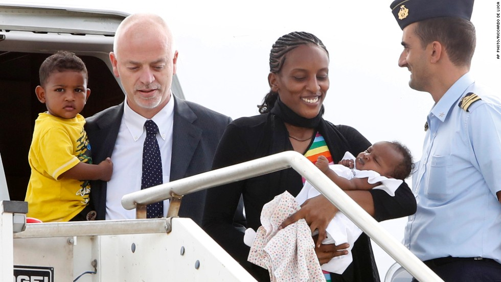 "JULY 24 - CIAMPINO AIRPORT, ITALY: <a href=""http://cnn.com/2014/07/24/world/europe/italy-sudan-christian-woman/index.html"">Meriam Ibrahim </a>disembarks an aircraft with her children Maya, in her arms, and Martin, and is greeted by Italian deputy Foreign Minister Lapo Pistelli, after departing from Khartoum. The Sudanese woman was sentenced to death in her country for refusing to renounce her Christian faith."