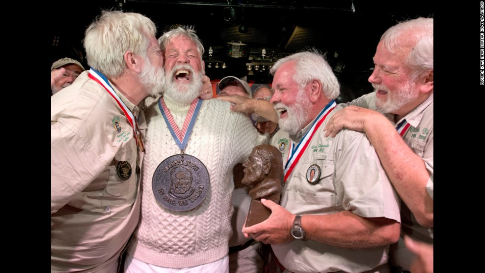 Wally Collins, second from left, is congratulated Saturday, July 19, after beating 130 other men in the annual Ernest Hemingway look-alike contest in Key West, Florida. The Pulitzer Prize-winning author lived in Key West during the 1930s and wrote some of his famous work there.