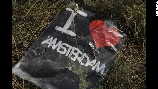 "HRABOVE, UKRAINE:  ""Passengers aboard Malaysia Airlines flight 17 (MH17) traveled with personal effects that tell who they were, what they liked and shopped. Now, strewn on an Eastern European field, these objects are misplaced."" - CNN's Diego Laje, July 24.  Follow Diego (@lajeasia) and other CNNers along on Instagram at instagram.com/cnn."