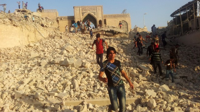 People walk on the rubble of the destroyed Mosque of The Prophet Younis, or Jonah, in Mosul, 225 miles (360 kilometers) northwest of Baghdad, Iraq, Thursday, July 24, 2014. The revered Muslim shrine was destroyed on Thursday by militants who overran the city in June and imposed their harsh interpretation of Islamic law. The mosque was built on an archaeological site dating back to 8th century BC, and is said to be the burial place of the prophet, who in stories from both the Bible and Quran is swallowed by a whale. (AP Photo)