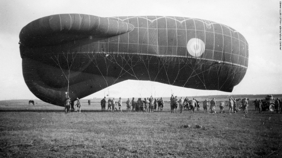 ... and this not-very-subtle sausage-shaped observation balloon in France on November 10, 1918. The balloons were used for, among other things, artillery spotting.  Because they were filled with flammable hydrogen, they were well-guarded by anti-aircraft artillery.