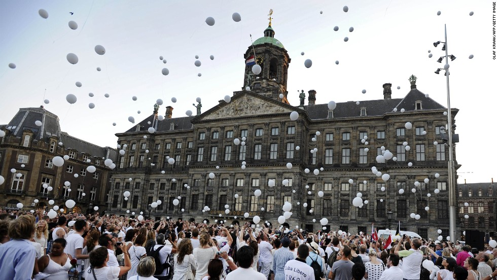 "JULY 25 - AMSTERDAM: People release white balloons into the air during a silent march in memory of the victims of the <a href=""http://edition.cnn.com/SPECIALS/world/mh17-specials-page/index.html?hpt=hp_inthenews"">downed Malaysia Airlines flight MH17</a>."
