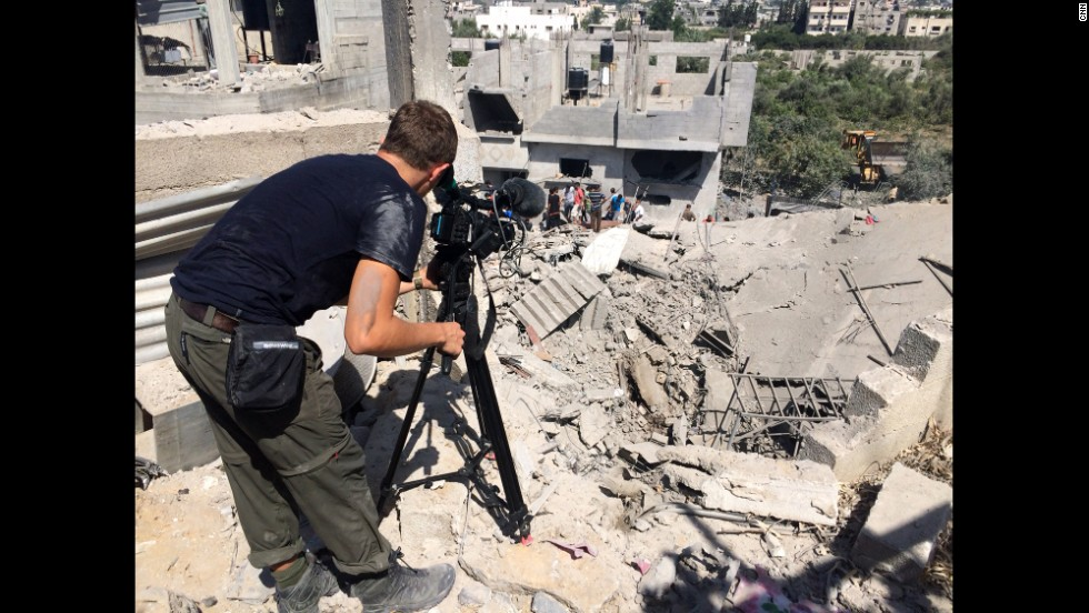 "CNN's Joe Sheffer shoots video of an attempt to rescue survivors at a destroyed house in Beit Hanoun during the cease-fire. ""The house was hit by a huge bomb in the early morning, killing the family inside,"" Sheffer said. ""Capturing even one-tenth of the destruction in a scene like this is nearly impossible."""