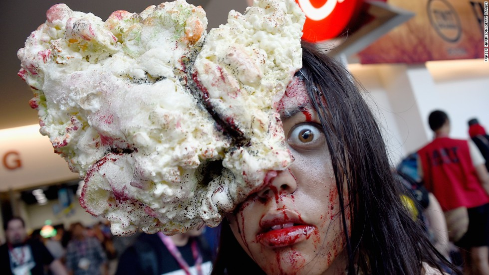 A gore-splattered attendee poses on July 26.