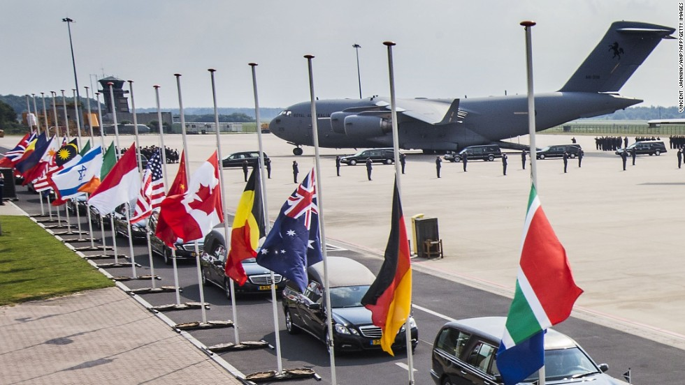Hearses carrying the coffins with the remains of the victims leave Eindhoven airbase on July 26