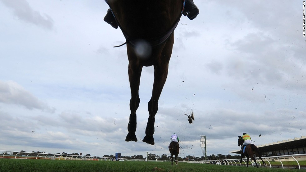 Horses race in the Grand National Steeplechase held Sunday, July 27, in Melbourne.