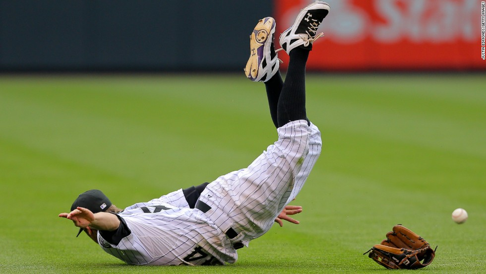 Colorado shortstop Josh Rutledge is unable to make a catch during a game in Denver on Sunday, July 27.