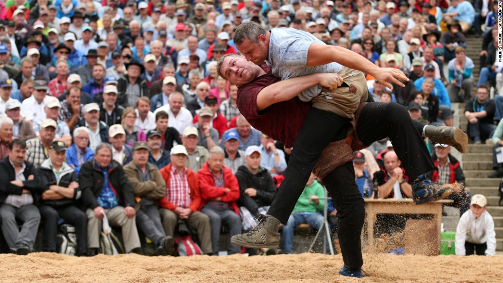 Swiss Alpine wrestler Christian Stucki, left, tries to throw Arnold Forrer during the Alpine Wrestling festival Bruenig-Schwinget on Sunday, July 27, in Meiringen, Switzerland.