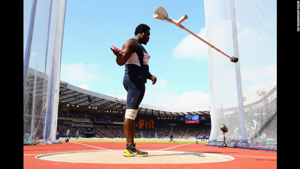 Nigerian Paralympic athlete Richard Okigbazi throws his walking aid away before competing in the men's discus final at the Commonwealth Games in Glasgow, Scotland, on Monday, July 28. Okigbazi, who has only one leg, finished third in the event behind England's Dan Greaves.