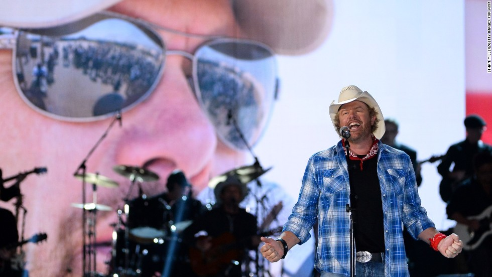 "Toby Keith topped the Forbes <a href=""http://www.forbes.com/sites/zackomalleygreenburg/2014/07/28/the-worlds-highest-paid-country-musicians-2014/"" target=""_blank"">list of highest-earning country stars of 2013.</a> The singer, whose 2013 album was ""Drinks After Work,"" made $65 million last year -- much of it from business interests such as a chain of restaurants."