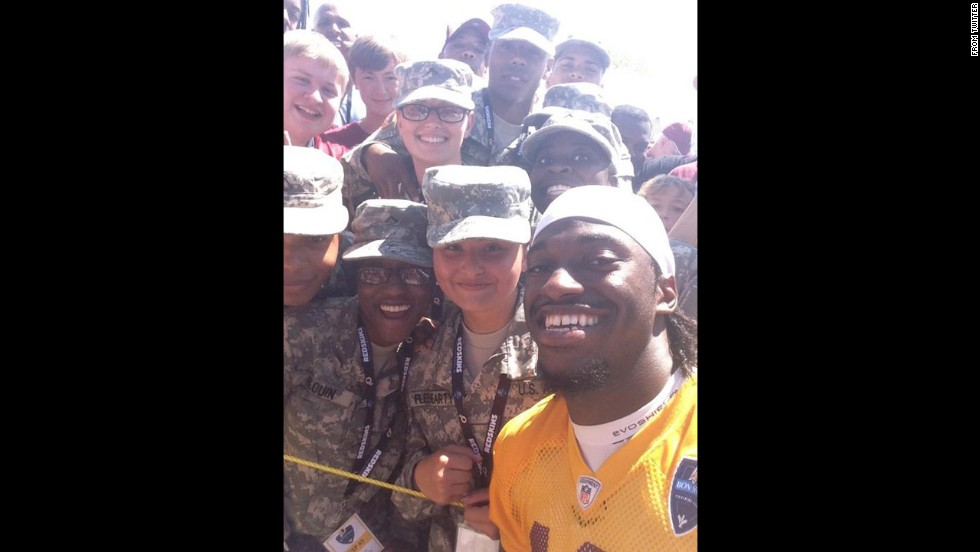 "Washington Redskins quarterback Robert Griffin III <a href=""https://twitter.com/RGIII/status/492723451325460481"" target=""_blank"">tweeted a selfie</a> he took with fans at training camp on Friday, July 25. ""Selfie w/ the Best fans in the world baby!"" he wrote. ""Love y'all & thank y'all for coming out every day to support us."" The Redskins are training in Richmond, Virginia, for the upcoming NFL season."