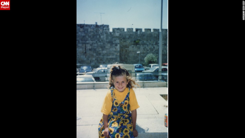 Naim Naif's second oldest sister, Atheer, sits in front of the wall of the old city in Jerusalem in 1998.