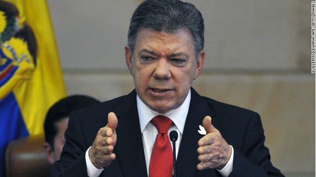 Colombian President Juan Manuel Santos delivers a speech during the installation of the new Congress (2014-2018) at the Capitol in Bogota, Colombia, on July 20, 2014. Santos settled on Sunday which he called the Congress of peace and called on lawmakers to support the task to carry out the agreements and rules for a 'post-conflict nation.' AFP PHOTO/Guillermo Legaria (Photo credit should read GUILLERMO LEGARIA/AFP/Getty Images)