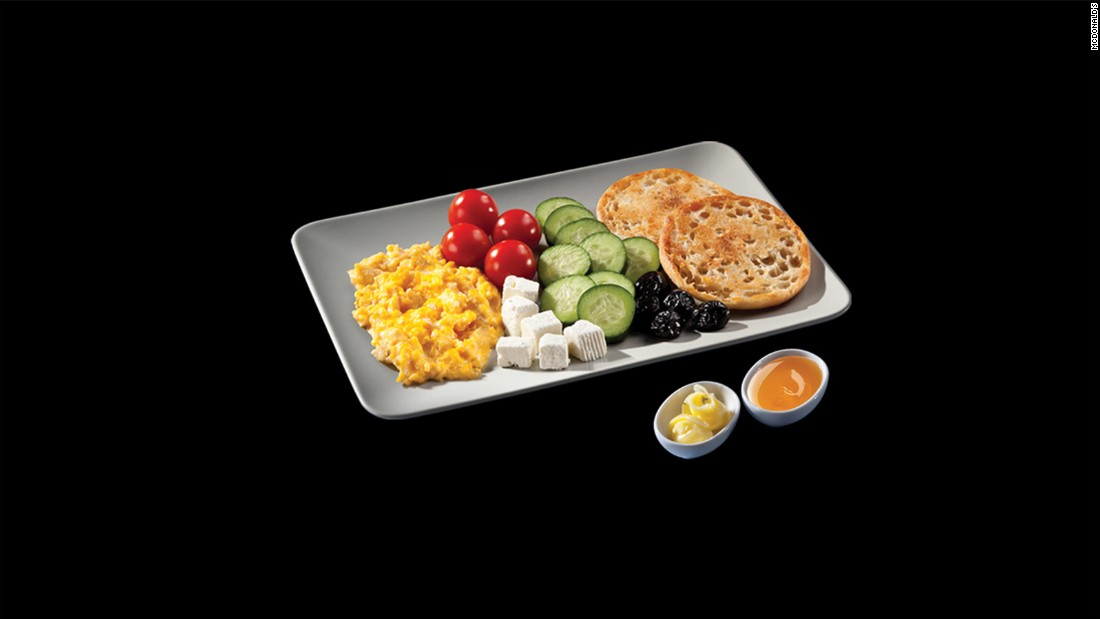 This breakfast plate served at McDonald's Turkey consists of eggs, tomatoes, feta cheese, cucumbers, berries, toast, and honey. You might almost forget you're at a fast food chain.