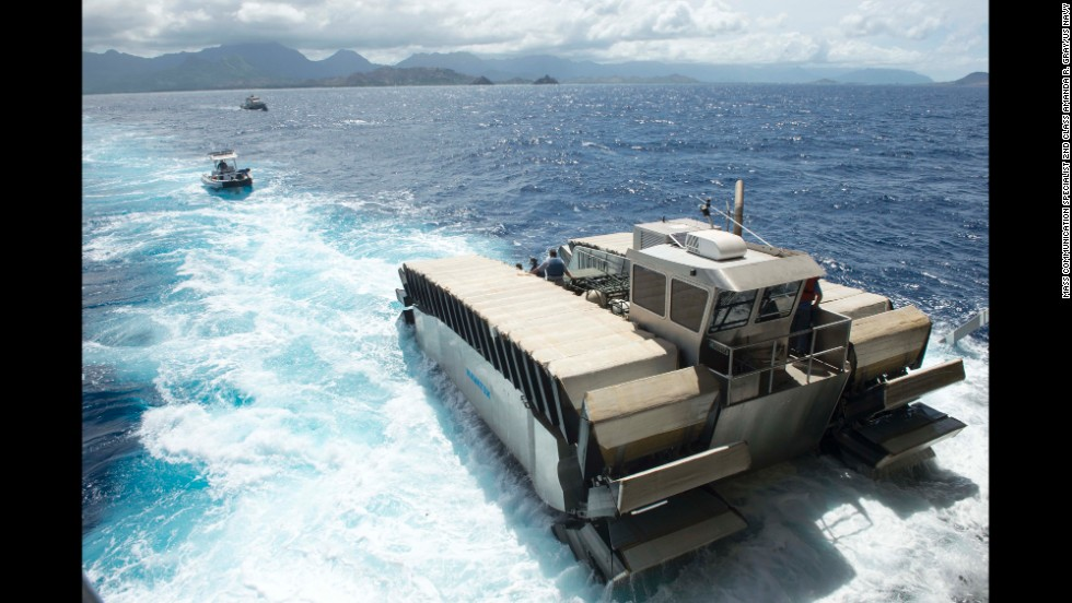 "A half-scale <a href=""http://www.cnn.com/2014/07/16/tech/innovation/marines-amphibious-vehicle/index.html"" target=""_blank"">Ultra Heavy-lift Amphibious Connector prototype</a>, created by Navatek Ltd. and the Office of Naval Research, departs the amphibious dock landing ship USS Rushmore on July 11. The UHAC was unveiled during RIMPAC exercises."