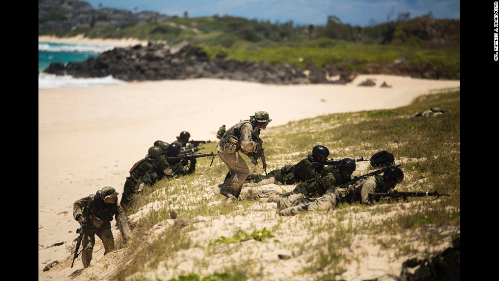 Japanese soldiers participate in an amphibious assault exercise July 1 at Pyramid Rock Beach, Hawaii.