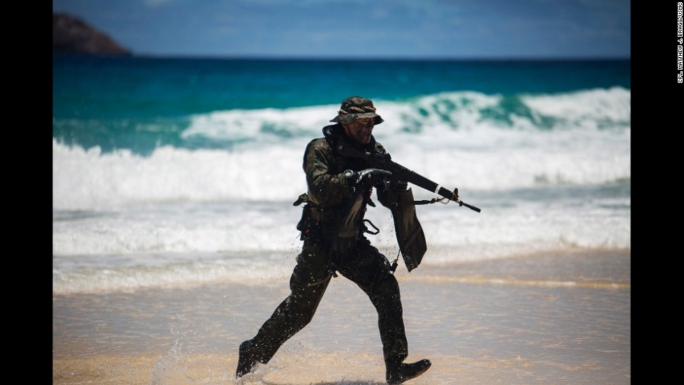A Japanese soldier sprints to take a position on Pyramid Rock Beach during the July 1 training exercise.
