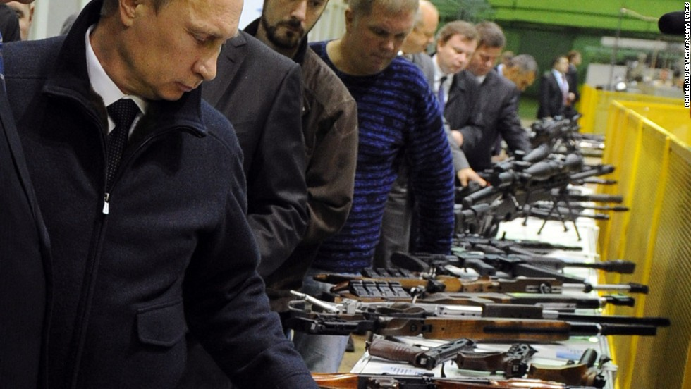 Russia's largest firearms manufacturer is among nine of the country's arms firms that have had U.S. assets frozen. It has been banned from doing business with American companies or individuals. Pictured here is Russia's President Vladimir Putin in Kalashnikov factory.