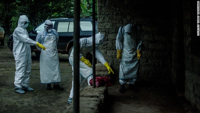A team of Red Cross volunteers prepares to enter a house in Pendembu, Sierra Leone, on July 18 where an Ebola victim died.