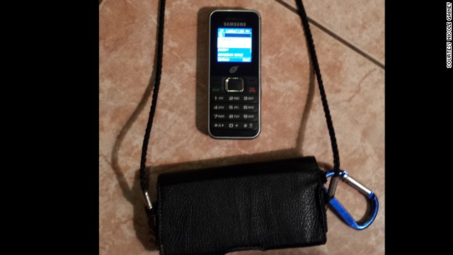 The cell phone and holder that Dominic carries at his mom's instructions.
