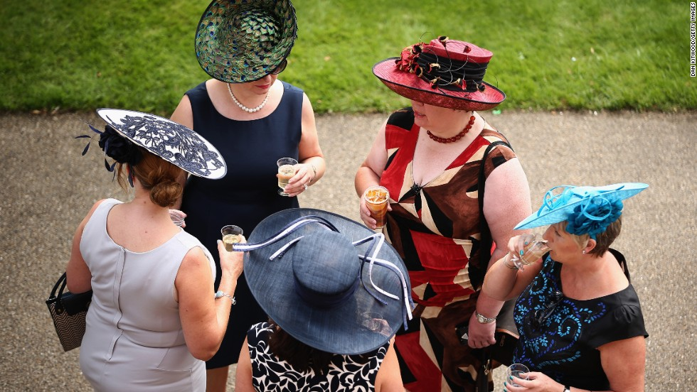 Visitors show off their millinery masterpieces at the track ...