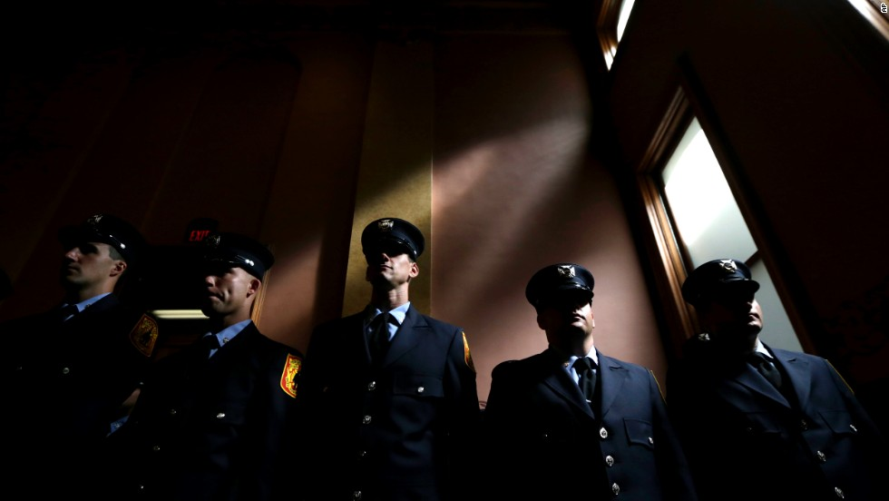 Cadets attend a swearing-in ceremony in Jersey City, New Jersey, on Friday, July 25. The cadets were sworn in as Jersey City Fire Department firefighters.