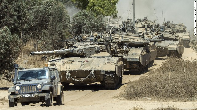 Israeli Merkava tanks roll to the southern Israeli border with the Gaza Strip, on August 1, 2014. Israeli forces in the southern Gaza Strip are searching for a missing soldier they fear may have been captured by militants at the start of a new ceasefire, the army said.