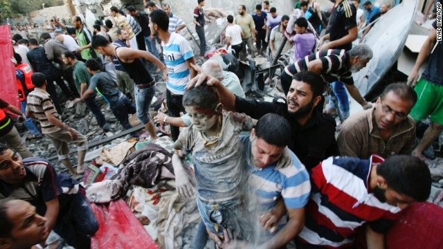 Palestinians evacuate a survivor of an Israeli air strike that hit the Al Ghoul family building in Rafah, southern Gaza on August 3.