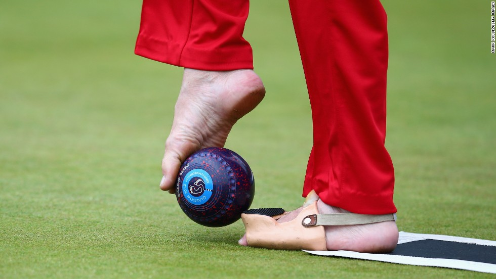 English lawn bowler Bob Love, who was born without arms, prepares to use his feet to bowl in a bronze-medal match Thursday, July 31, at the Commonwealth Games in Glasgow, Scotland. Love and his teammates, David Fisher and Paul Brown, defeated Scotland to take bronze in the open triples B6/B7/B8 event.
