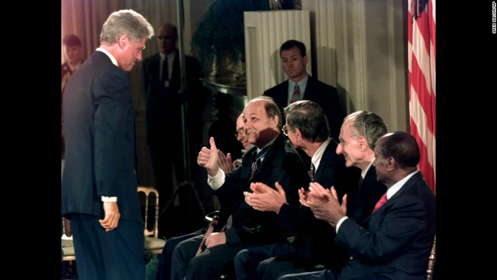 Brady gives a thumbs-up to Clinton at the White House on September 9, 1996. Brady was receiving the Presidential Medal of Freedom, the highest civilian award in the United States.