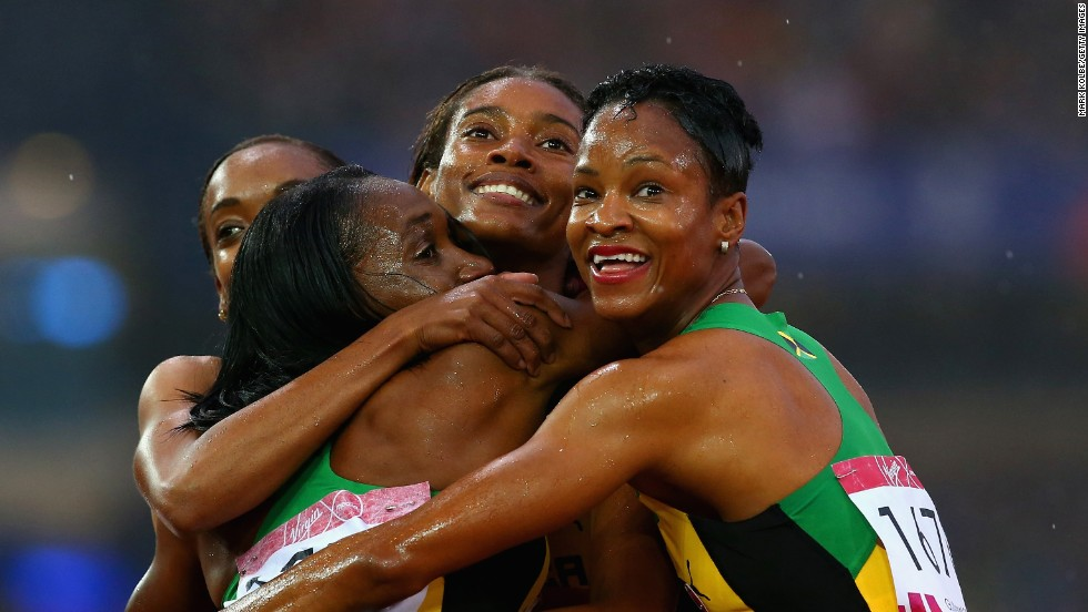 Jamaican sprinters Christine Day, Novlene Williams-Mills, Anastasia Le-Roy and Stephenie McPherson embrace after winning gold in the 4x100-meter relay Saturday, August 2, at the Commonwealth Games in Glasgow, Scotland.