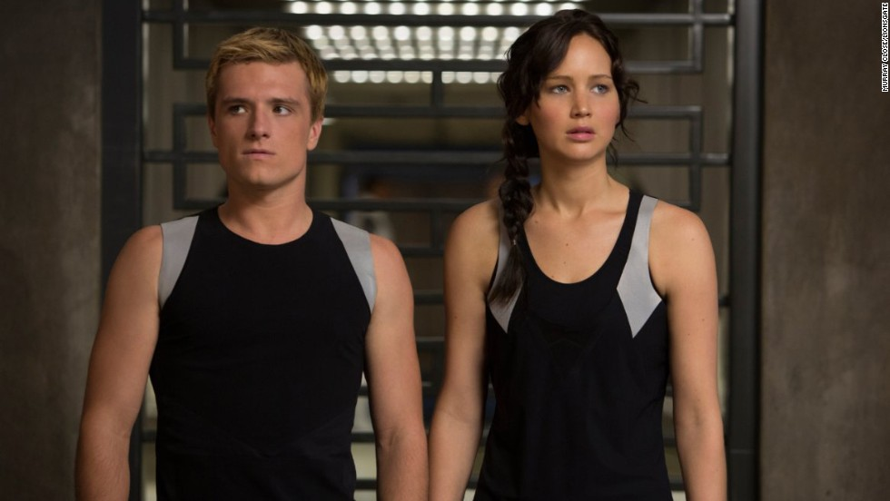 "<strong>""The Hunger Games"":</strong> Suzanne Collins' trilogy is set in Panem, a totalitarian U.S. successor. The Hunger Games are an annual competition in which adolescents from its 12 regions compete to the death to entertain the populace. The movies star Jennifer Lawrence (right, with Josh Hutcherson) in the lead role as Katniss Everdeen, whose cleverness and skills soon prove a threat to the ruling order."
