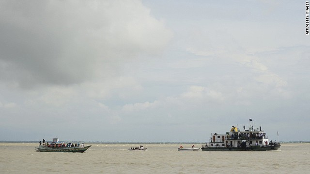 Bangladeshi rescue workers search the waters where an overloaded ferry capsized in the Padma river in Munshiganj, some 30 kilometres (20 miles) south of the capital Dhaka, on August 4, 2014. An overloaded ferry carrying up to 200 passengers sank August 4 on a river in central Bangladesh, police said. AFP PHOTO/Munir uz ZAMANMUNIR UZ ZAMAN/AFP/Getty Images