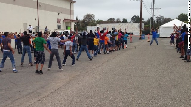 Unaccompanied minors at Naval Base Ventura County-Port Hueneme in California exercise while they're being held at the facility.