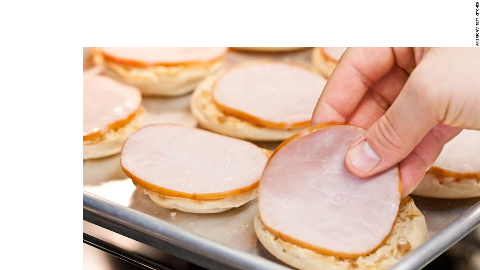 10. Place 1 slice of Canadian bacon (12 slices total) on each English muffin and broil until beginning to brown, about 1 minute. Remove baking sheet from oven.