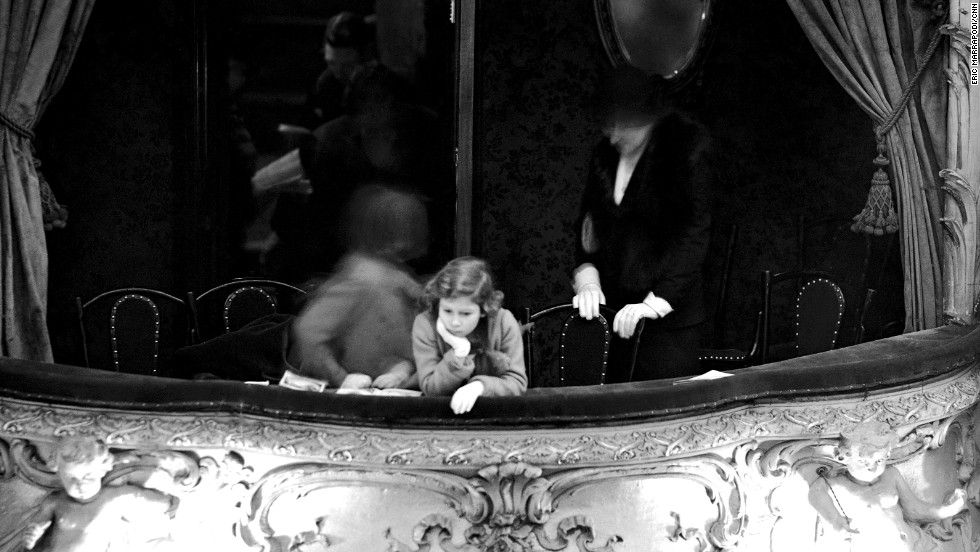 Princess Elizabeth is seen in the Duchess' box during a pantomime act at London's Lyceum Theater in February 1935.