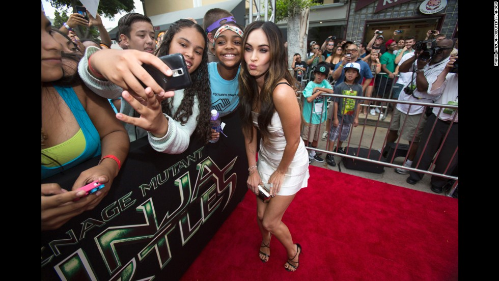 "Actress Megan Fox poses with fans Sunday, August 3, at the premiere of ""Teenage Mutant Ninja Turtles"" in Los Angeles."