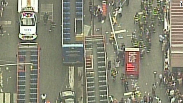 Two tour buses crash in Times Square