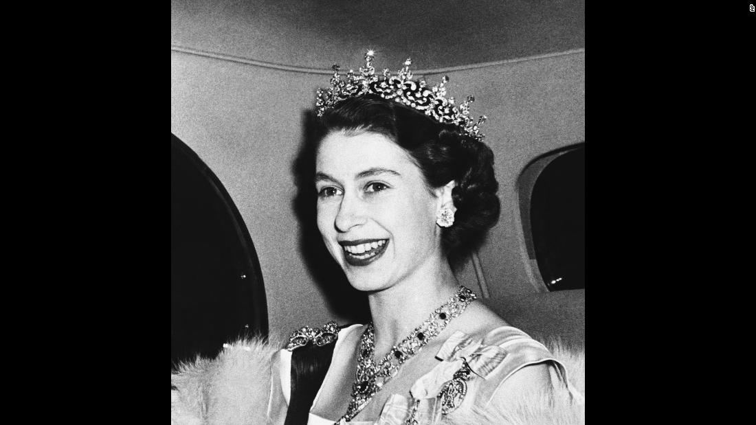 Princess Elizabeth smiles in March 1950 as she arrives to a state banquet at the French Embassy in London's Kensington Palace Gardens.