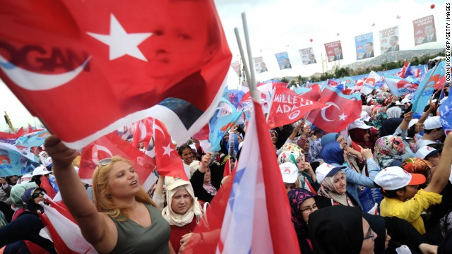 Supporters of Recep Tayyip Erdogan wave Turkish flags during a rally on August 3, 2014 in Istanbul.