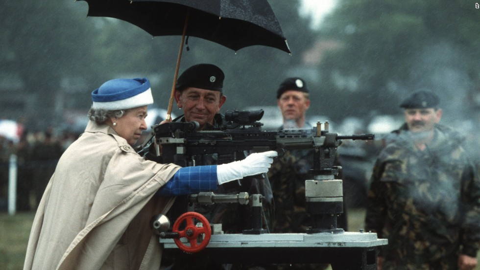 Queen Elizabeth II fires a rifle during a visit to the Army Rifle Association at Bisley, England, in July 1993.