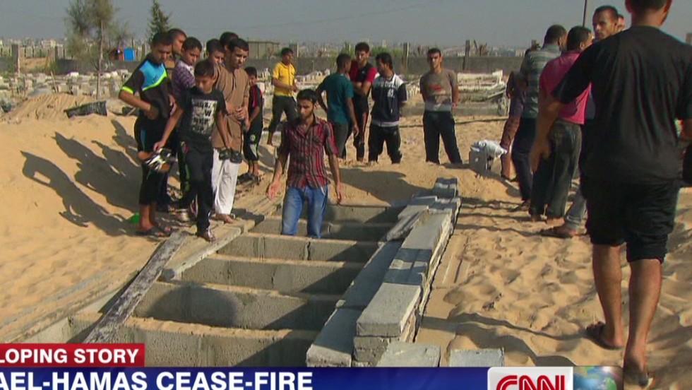 Rafah families rush to bury dead - CNN Video