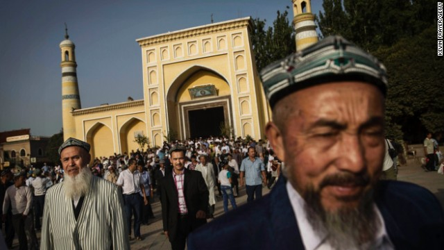 File: Uyghur men leave a mosque in Xinjiang Province, China on July 29, 2014.