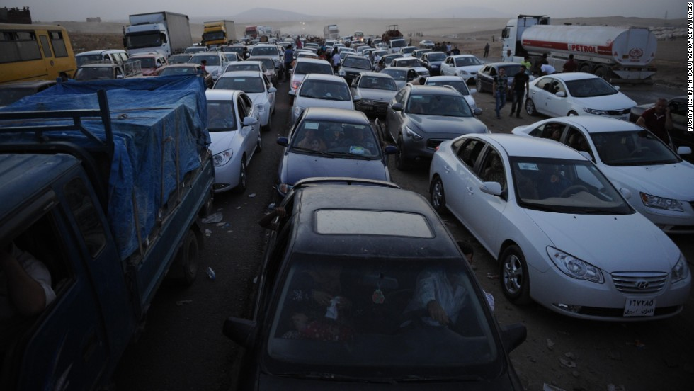 "Thousands of Yazidi and Christian people flee Mosul, Iraq, on Wednesday, August 6, after the latest wave of advances by the militant group ISIS. ISIS -- known for killing dozens of people at a time and carrying out public executions, crucifixions and other acts -- <a href=""http://www.cnn.com/2014/06/13/world/gallery/iraq-under-siege/index.html"">has taken over large swaths of northern and western Iraq</a> as it seeks to create an Islamic state that stretches from Syria into Iraq."