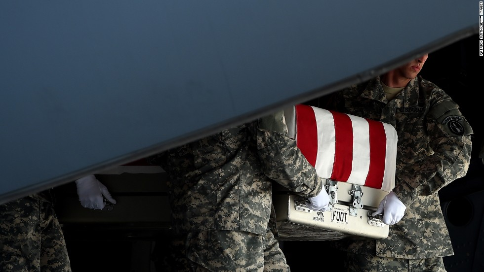 "U.S. Army soldiers carry the flag-draped transfer case containing the remains of <a href=""http://www.cnn.com/2014/08/05/us/afghanistan-general-greene/index.html"">Army Maj. Gen. Harold J. Greene</a> during a dignified transfer Thursday, August 7, at Dover Air Force Base in Dover, Delaware. Greene, the most senior U.S. officer to be killed since 9/11, died when a gunman believed to be an Afghan soldier <a href=""http://www.cnn.com/2014/08/05/world/asia/afghanistan-violence/index.html"">opened fire at a training facility</a> in Kabul, Afghanistan, hitting the general and several others."