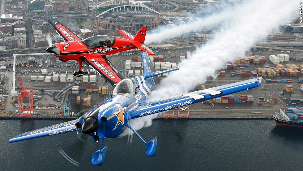 Pilots John Klatt, bottom, and Jeff Boerboon fly their planes in formation above Seattle on Saturday, August 2. The two performed that weekend in the Boeing Seafair Air Show.