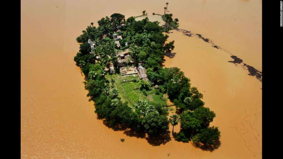 An aerial view shows houses cut off by monsoon floods Wednesday, August 6, in the Kendrapara District of eastern India. The annual monsoon season, which runs from June through September, is vital for the largely agrarian economies of South Asia, but it also brings floods and landslides that kill thousands and submerge hundreds of villages every year.