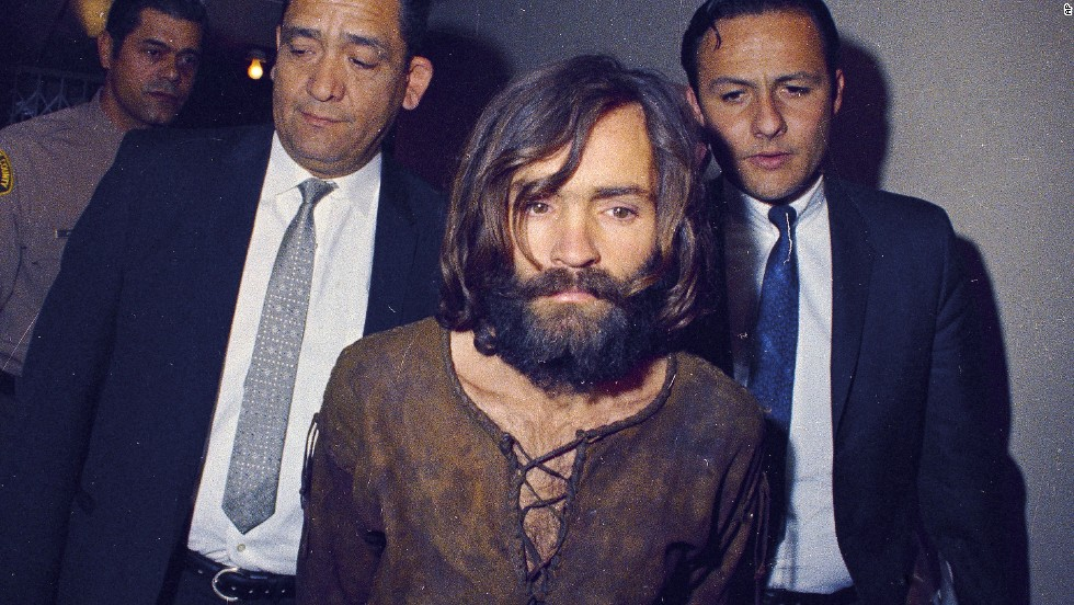 Manson is escorted to his arraignment on conspiracy-murder charges related to the murders.