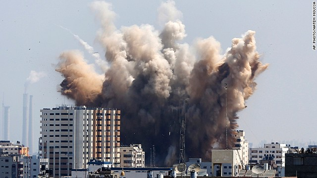 Smoke, dust and debris rise over Gaza City after an Israeli strike on August 8, 2014.