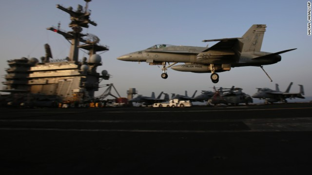 An F/A-18C Hornet coming from Iraq lands on the flight deck of the U.S. Navy aircraft carrier USS George H.W. Bush on August 10 in the Persian Gulf. Aircraft aboard the carrier are flying missions over Iraq after  President Barack Obama authorized airstrikes against Islamic militants and food drops for Iraqis trapped by the fighters.